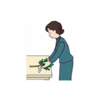 玉串の根もとを祭壇に向けたまま玉串案に置く。